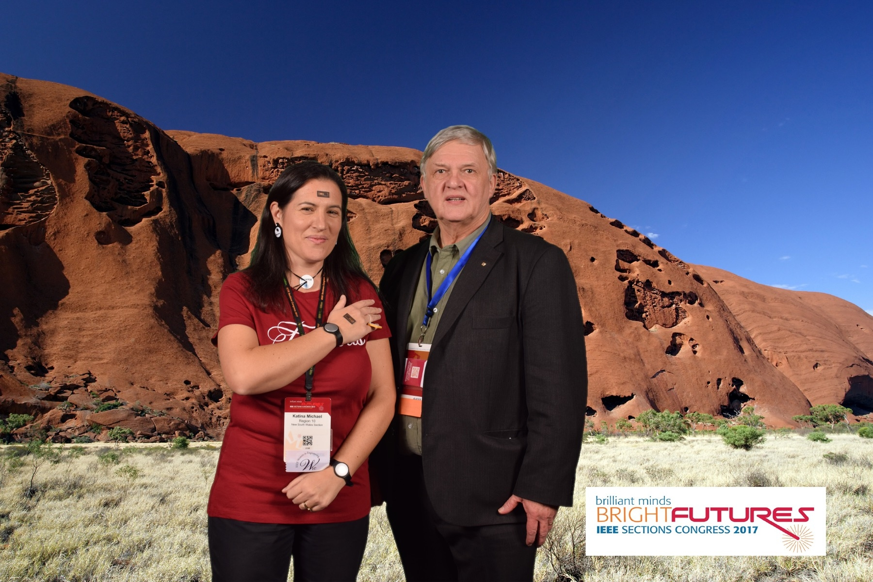 "Professor Katina Michael with 007 Stefan Mozer, Past President IEEE Consumer Electronics Society. Concern over the future of wearables and implantables. We chose a ""desert"" background at the photobooth, because if we continue on the current trajectory, the world will likely be barren, desolate and lifeless. Ironic that I was asked to speak on the ""pros and cons of implantables"" and the byline for this year's Sections Congress was ""brilliant minds 