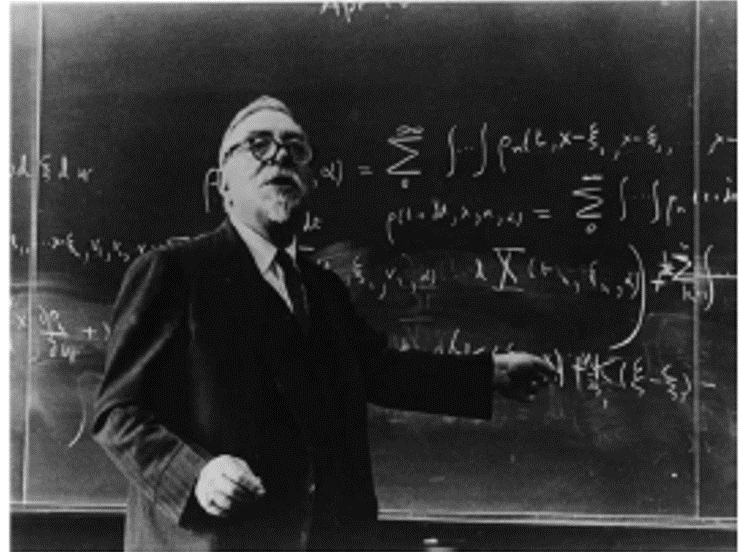 Fig. 3. Norbert Wiener at blackboard (courtesy of MIT Museum)