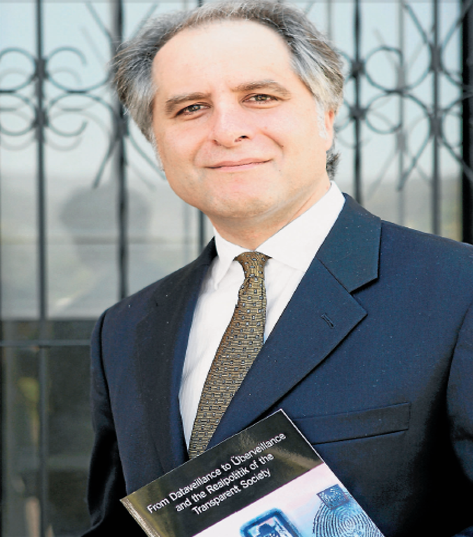 Dr MG Michael with his new book From Dataveillance to Uberveillance and the Realpolitik of the Transparent Society. Picture: ANDY ZAKELI