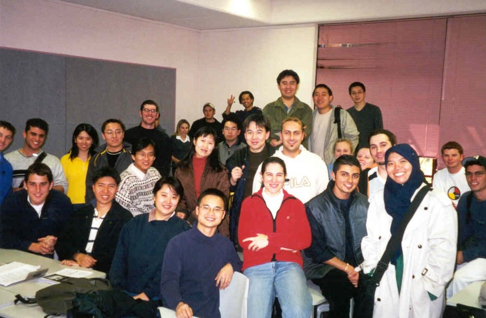 In 2001 I began tutoring at UOW, in IT Strategic Planning. Here is a photo from my very first class completion- the vast majority of this Masters class were international students who knew that studying IT post the dot.com crash was the way to go. I am in the foreground wearing a red GAP jacket, likely counterfeit, purchased just outside the US Embassy in Beijing at the Silk Markets in the preceding year. But that's another story...