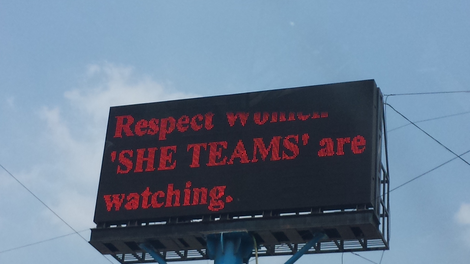 "Courtesy: Katina Michael. ""Sign in Hyderabad, India, displaying the need to respect women. And that ""SHE TEAMS"" are watching you if you do not."""