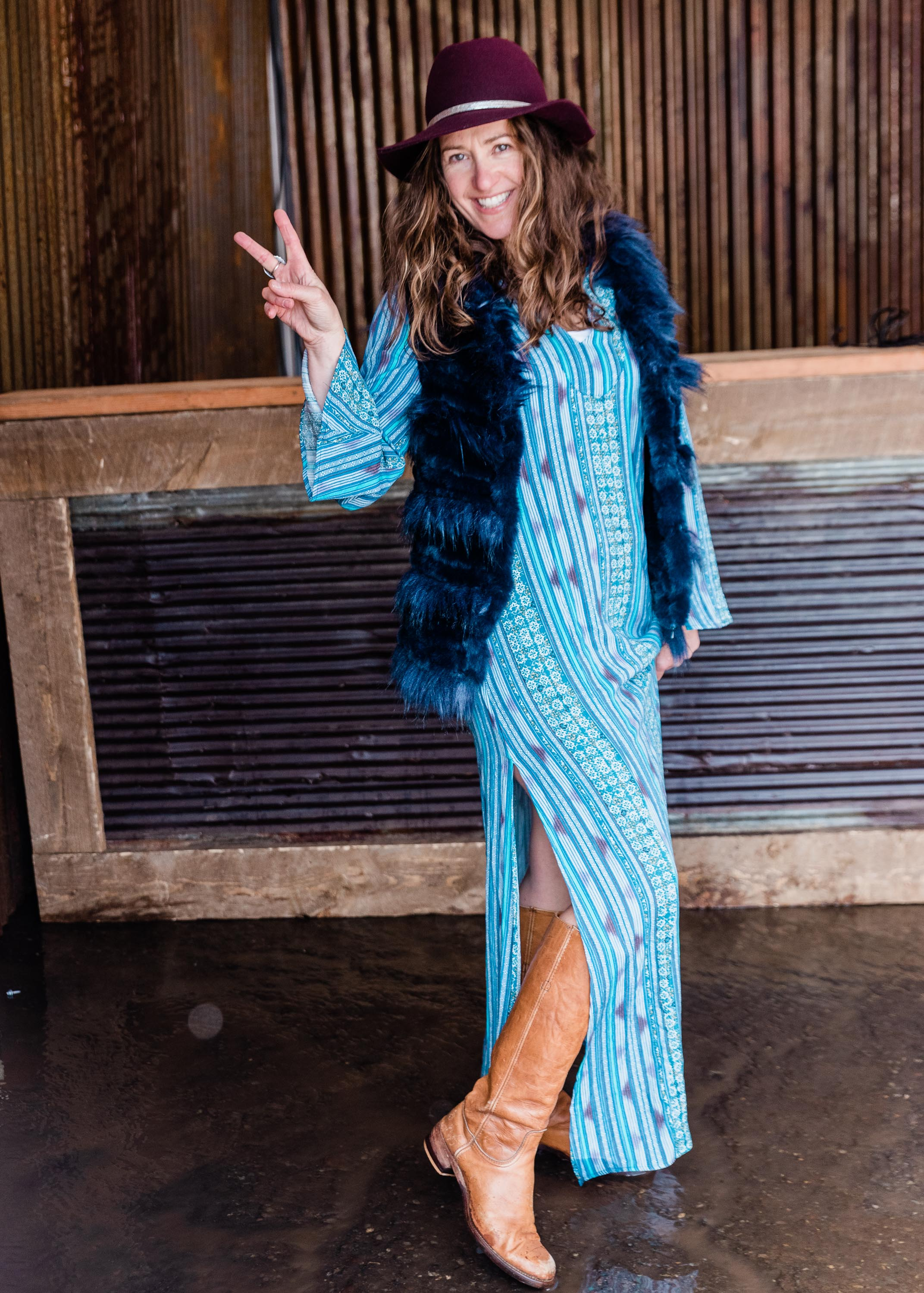 Bohemian Chic  Tysa's Seaside Kaftan dress paired with Frye Boots and Love Token's furry faux fur vest topped with a felt festival hat from Hat Attack will have people envious of your outfit while you are jamming in the front row.