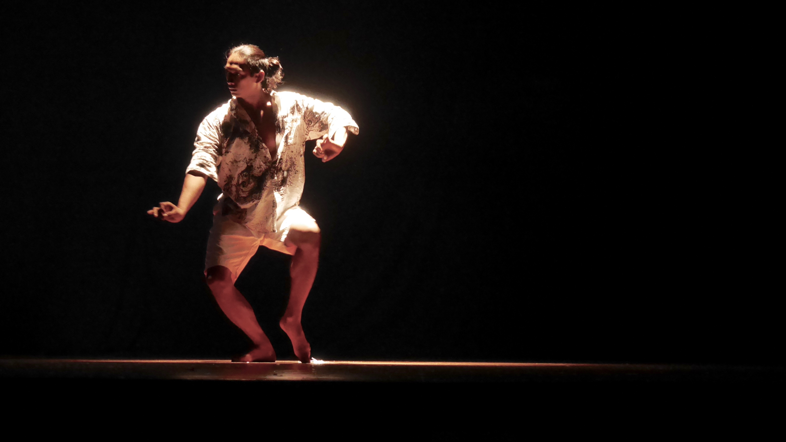 In the dark and light. A contemporary dance performance at GEOKS in Bali.