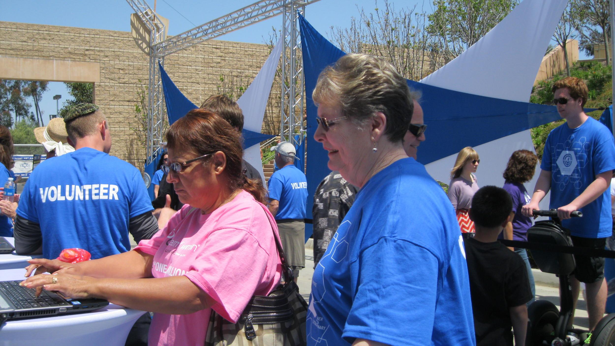 Linda assisting with Registration