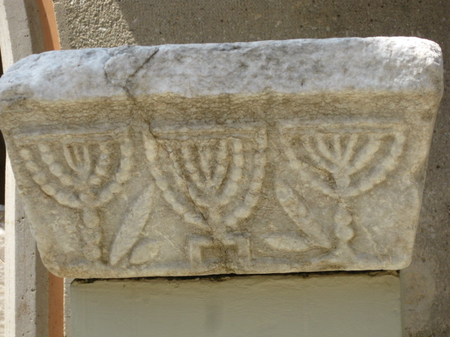 Stones with Menorahs found, but synagogue has not been excavated yet.