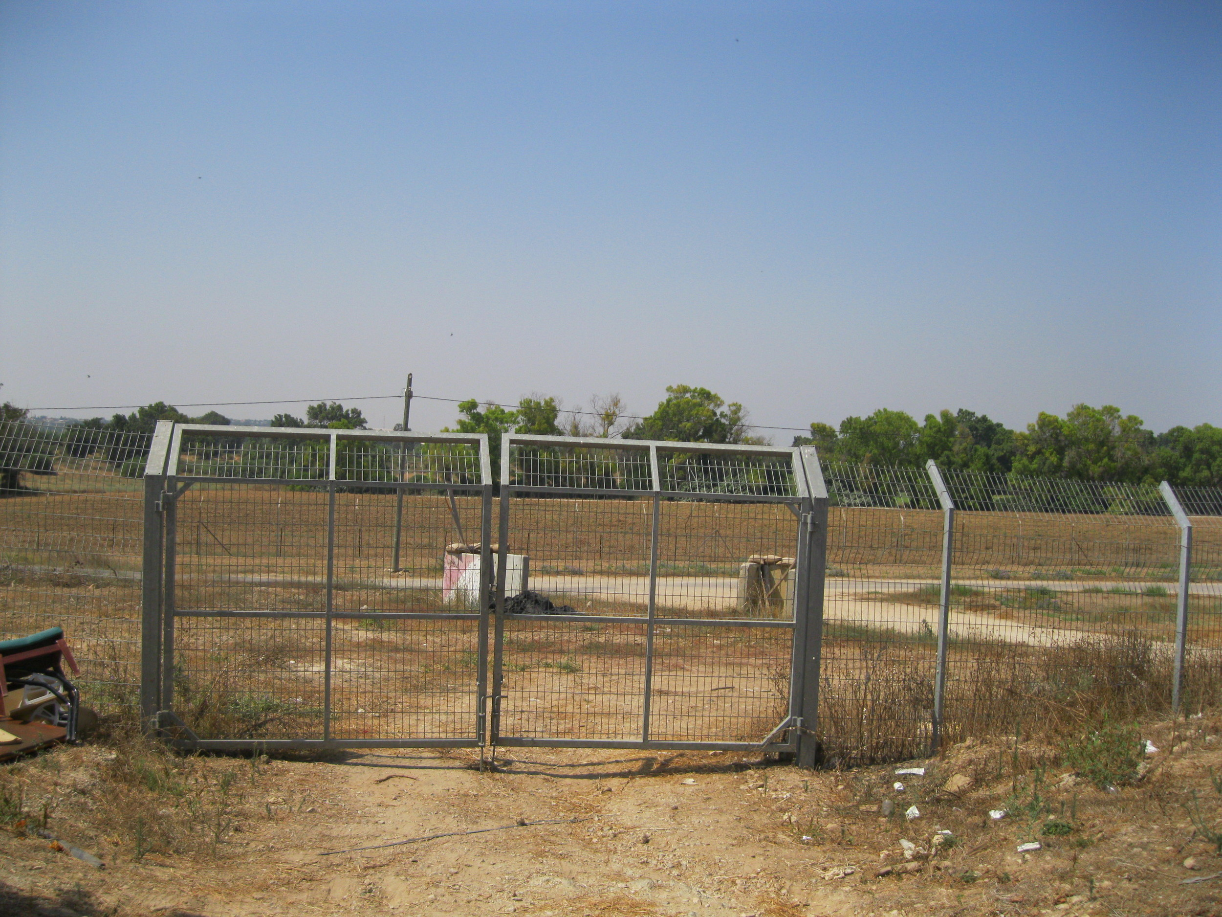 In the 2014 war, just outside this fence to the kibbutz, the Israeli Defense Force used this area as an outpost.  See next photo for close up.