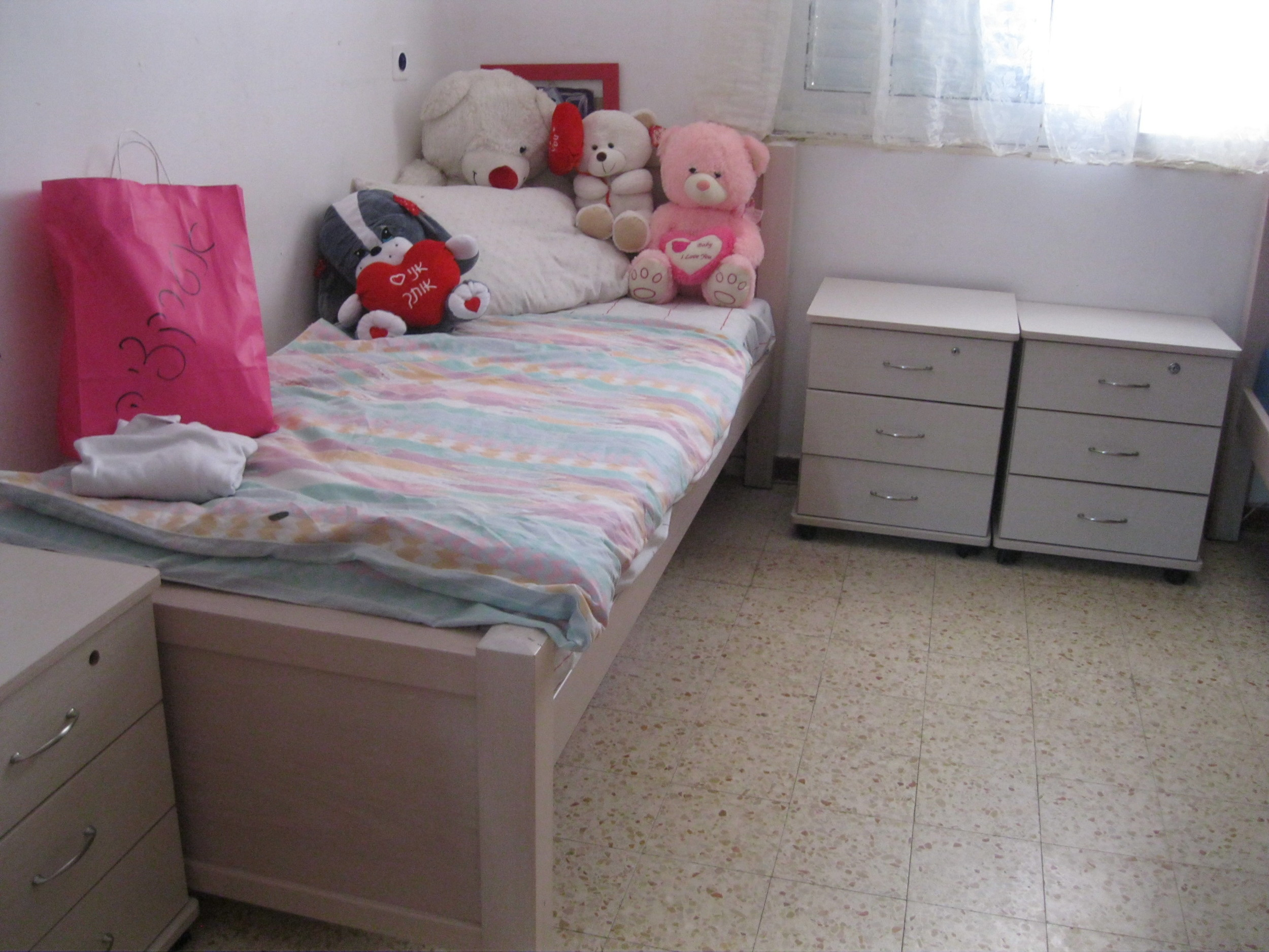 Bedrooms are shared. There is a bunkbed to the right of this, so there are three girls sharing this room.