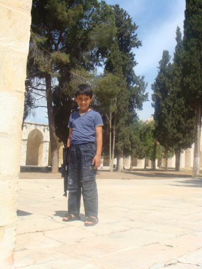 A young boy with a rifle allowed me to take his picture on the temple mount