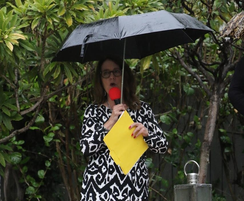 Deby teaches in rain.jpg