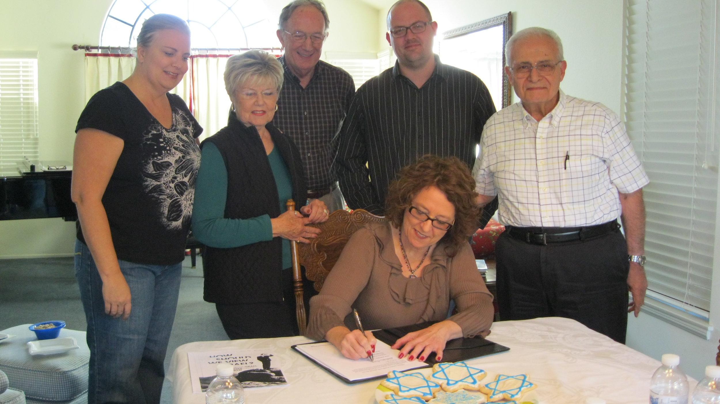 SFI Board signing non profit incorporation paperwork