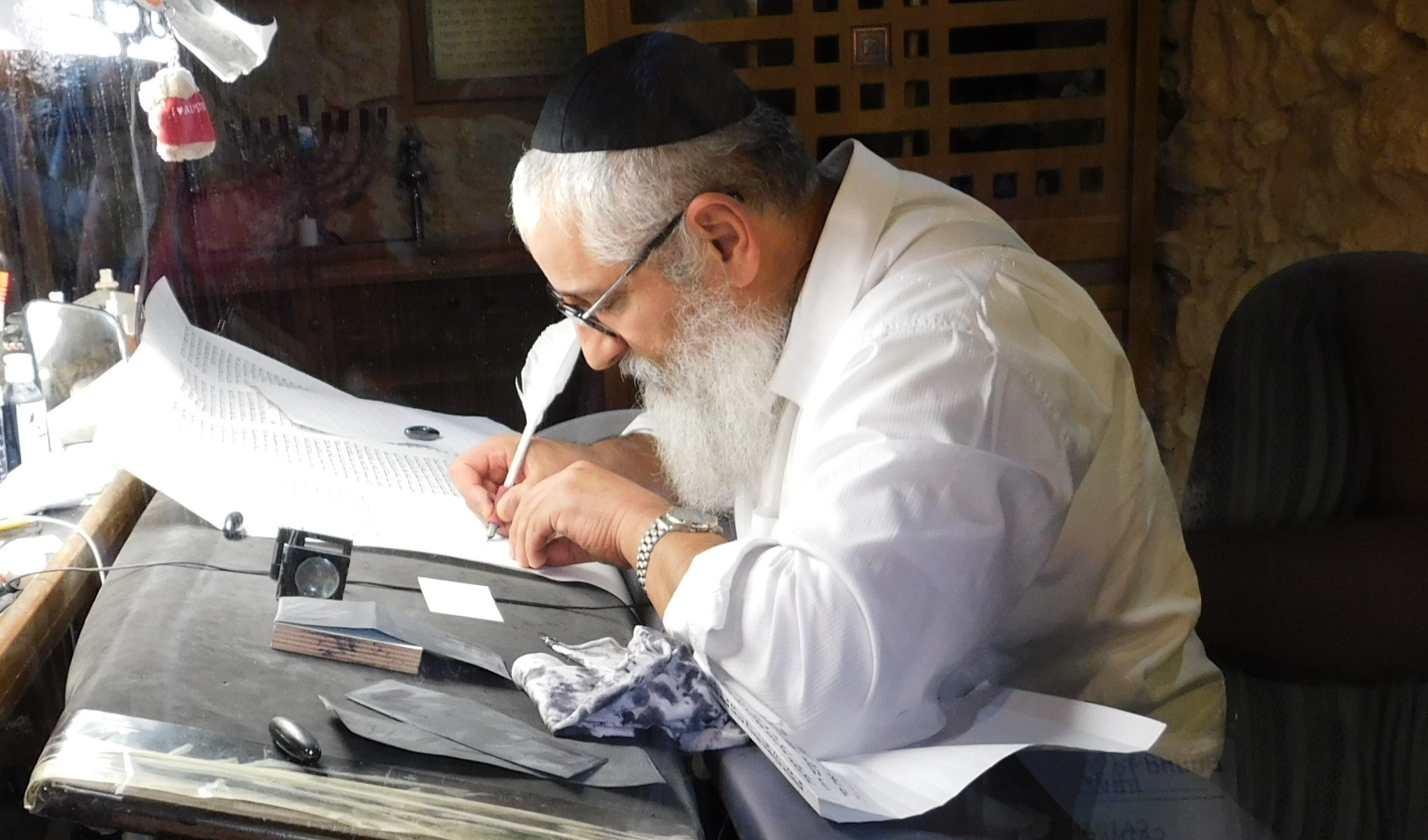 A Sofer (scribe) is writing out a Torah scroll at Masada.