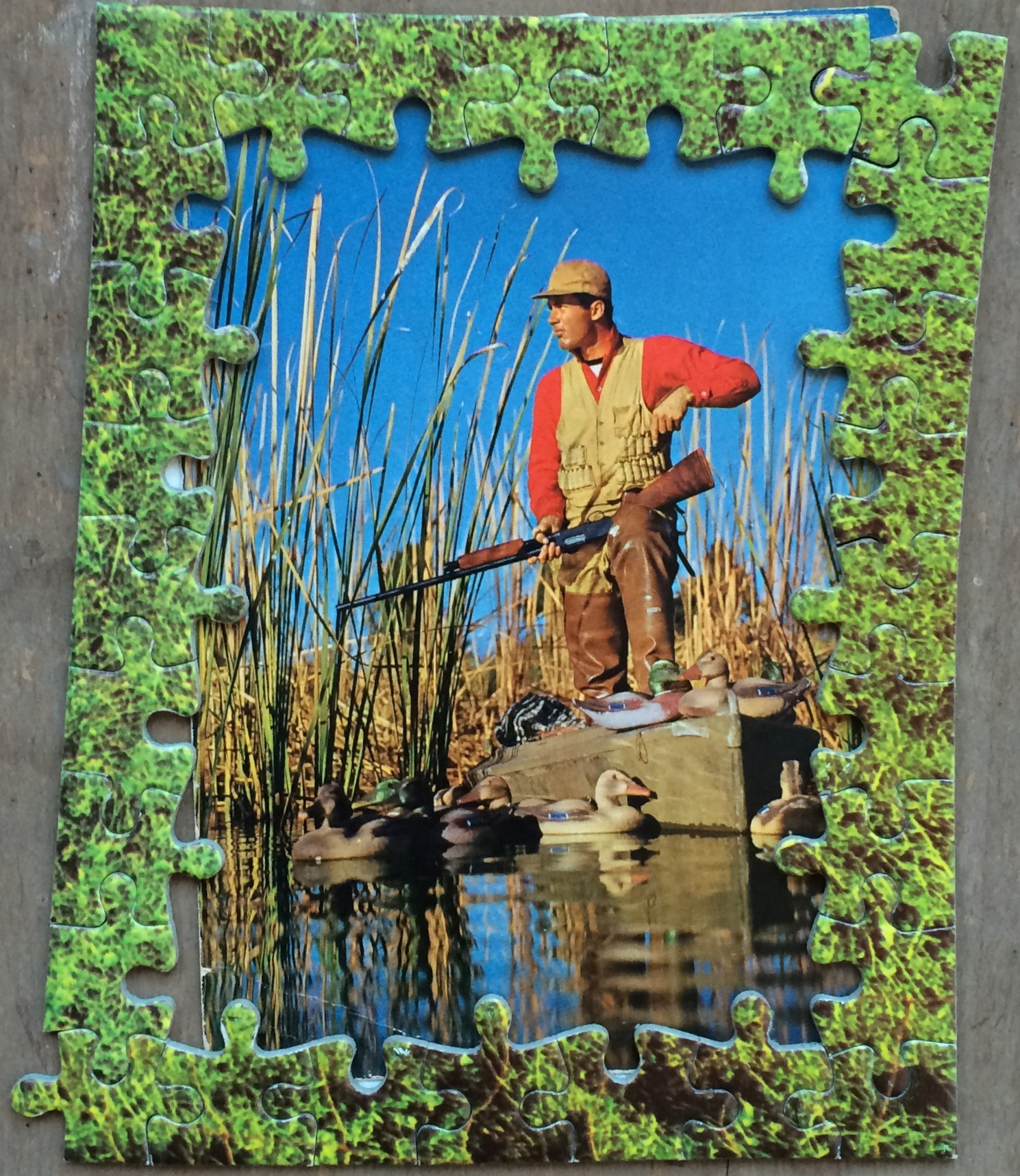 "Within the Reeds surveys Lloyd Barrington: Survivor at Large; 1968  2011, jigsaw and found card, ~5x3.7""  Copyright © Tennyson Woodbridge, 1963 to present;  Collection Eli Davey"