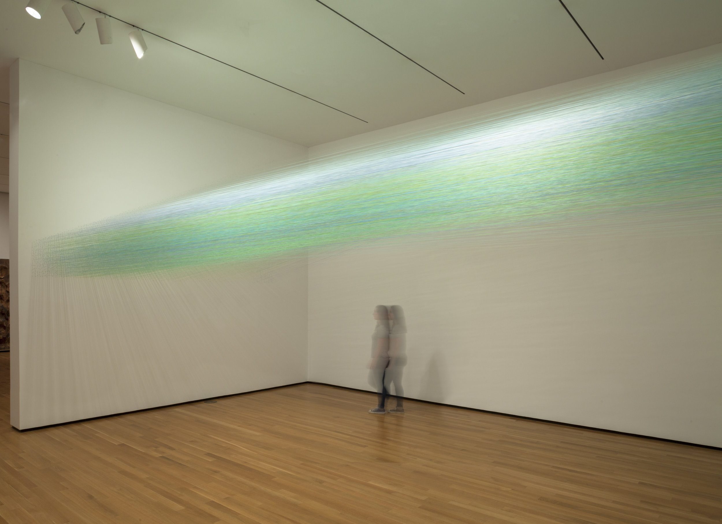"""Anne Lindberg, """"inside green,"""" 2016, thread and staples, 24 by 13.5 by 14.5 feet"""