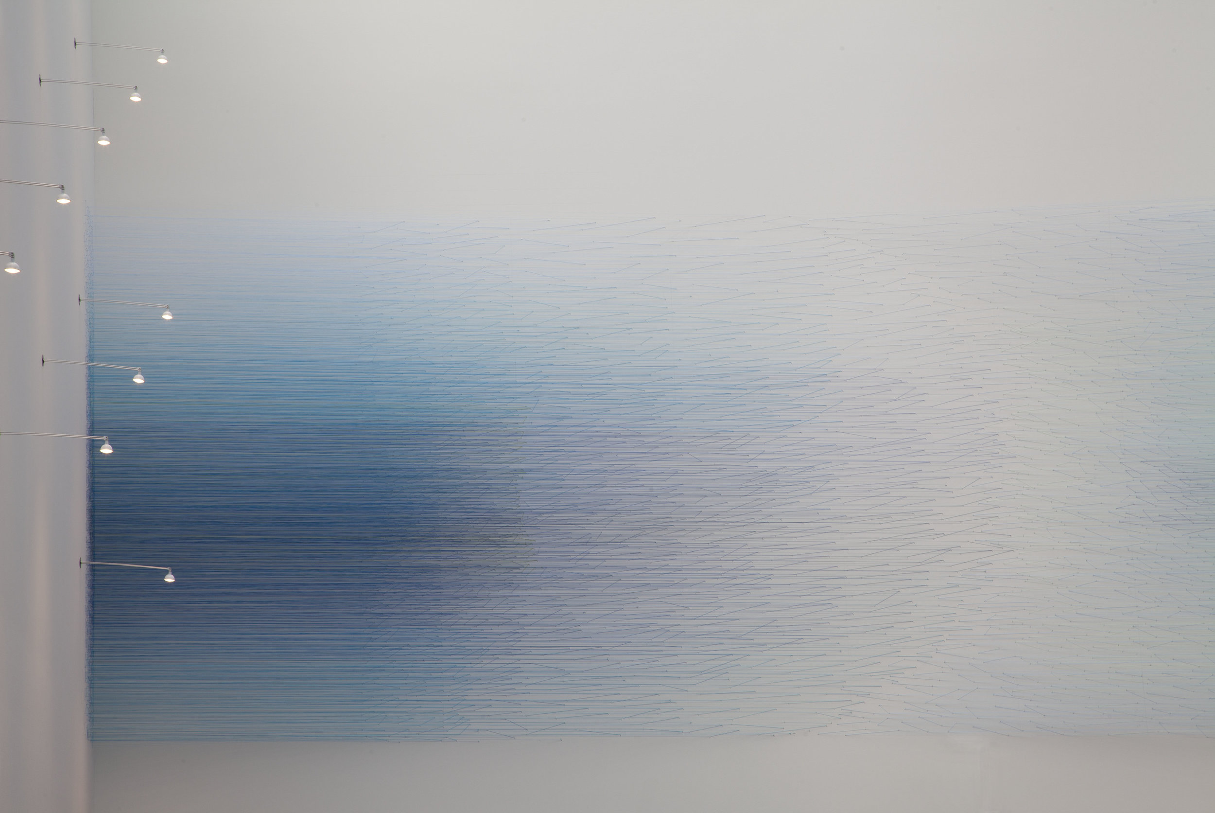 """Anne Lindberg,  """"At first the visible obscures:""""  thread and staples, 9 by 26 by 2ft - title is from Theodore Roethke's poem Unfold! Unfold!"""