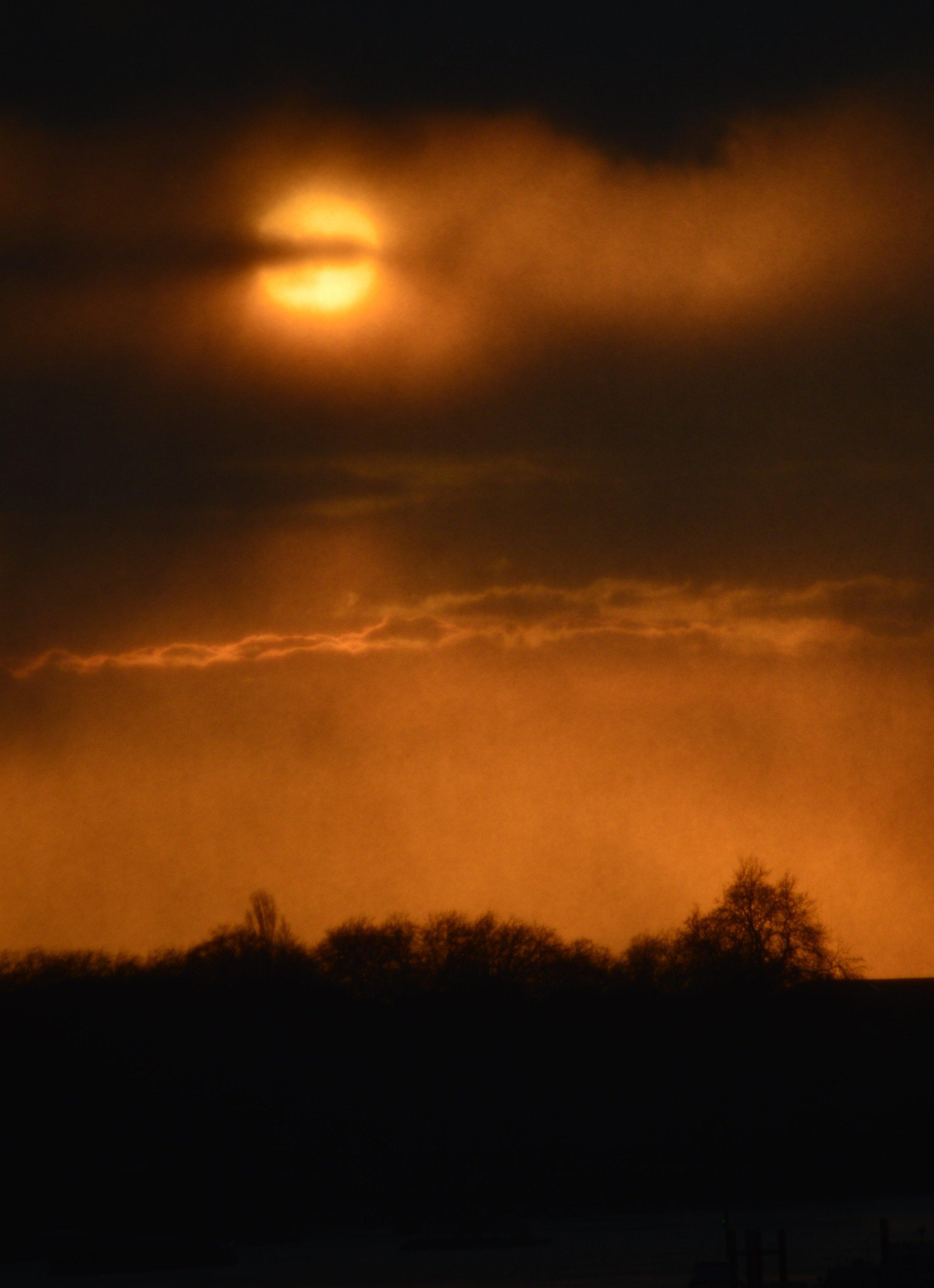 Sun shrouded by rain