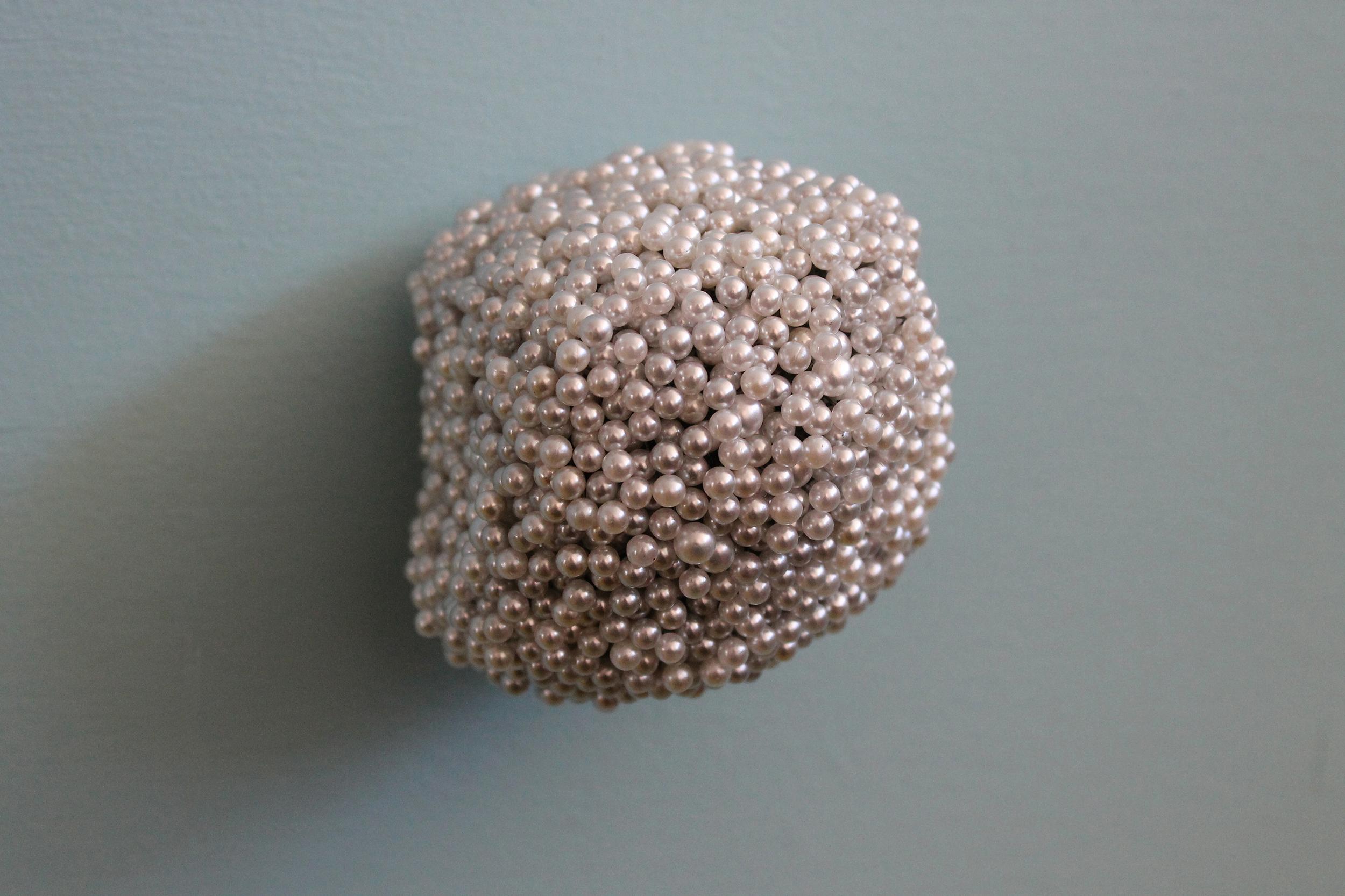 "Tickler #2  Pearl corsage pins, brass, industrial foam, 3 1/4"" x 3"" x 3"", 2012"