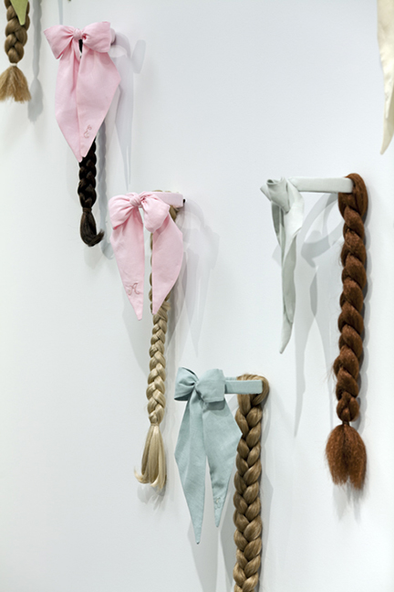 Lady-Ties for a Line Dance  Installation view at Phoenix Art Museum, 9 Braids: Linen, thread, brass, and artificial hair, 8' x 7', 2011