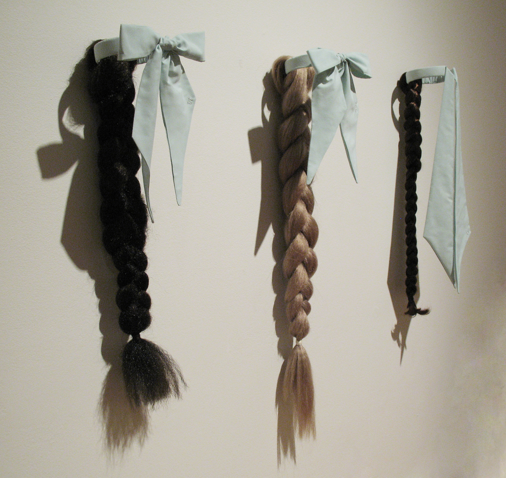 "For Both the Wearer and Their Partner  Hand-dyed fabric, synthetic hair, thread, and brass, 24"" x 7"" x 7"", 2011"