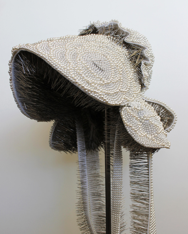 "Seer Bonnet XXVII (Hanna)  21,841 pearl corsage pins, fabric, steel, 62"" x 12"" x 14"", 2012-2013"