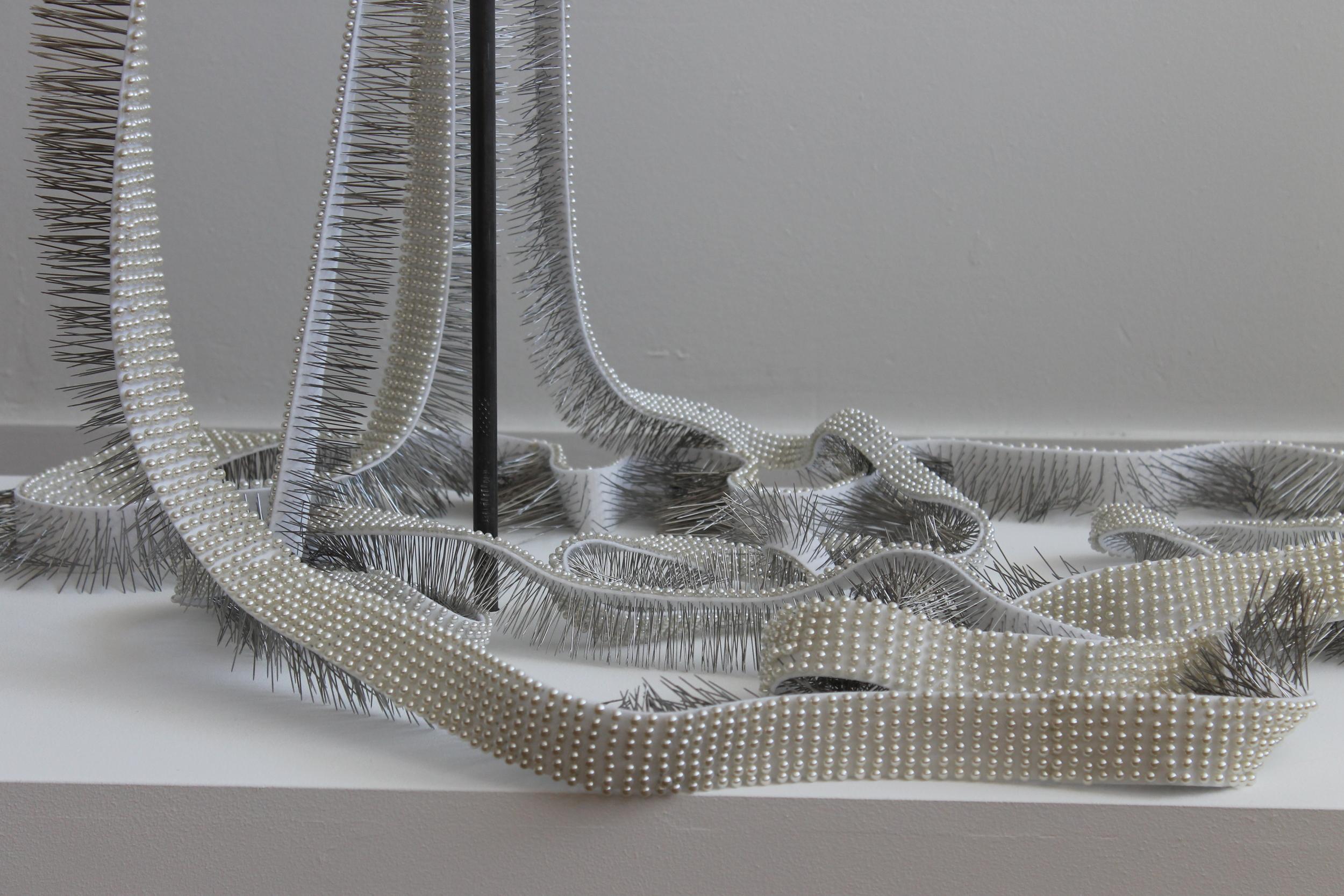 "Seer Bonnet XXI (Eliza Partridge) and Seer Bonnet XX (Emily Partridge) (detail) 39, 804 pearl corsage pins, fabric, steel, wood, 28"" x 68"" x 4"", 2011"