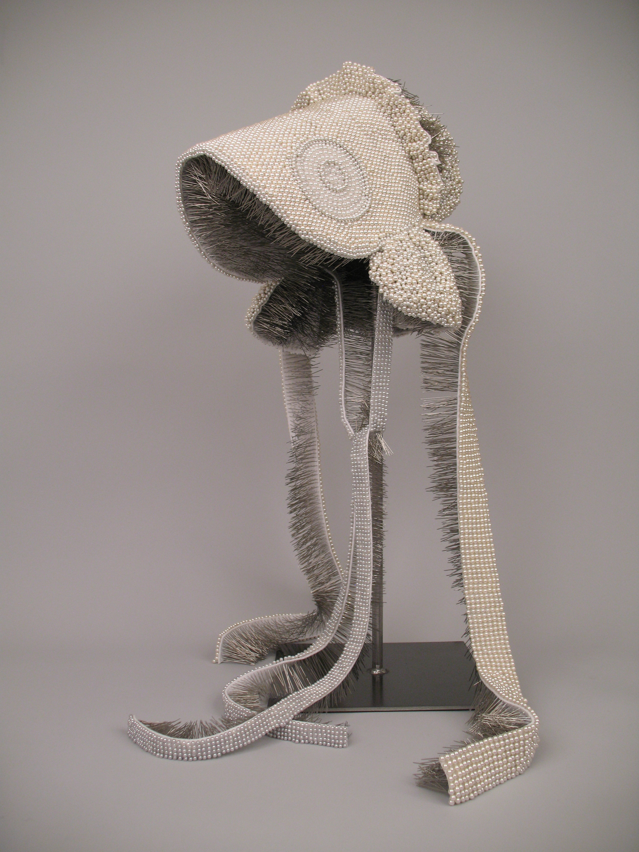 """Seer Bonnet XIII (Mary)  20,269 pearl corsage pins, fabric, steel, 28.5"""" x 12"""" x 15"""", 2010"""