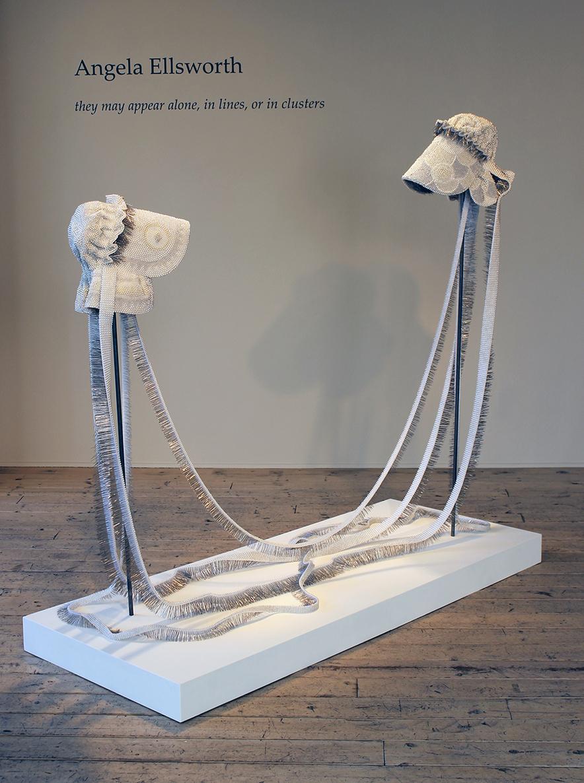"Seer Bonnet XXI (Eliza Partridge) and Seer Bonnet XX (Emily Partridge)  39, 804 pearl corsage pins, fabric, steel, wood, 28"" x 68"" x 4"", 2011"