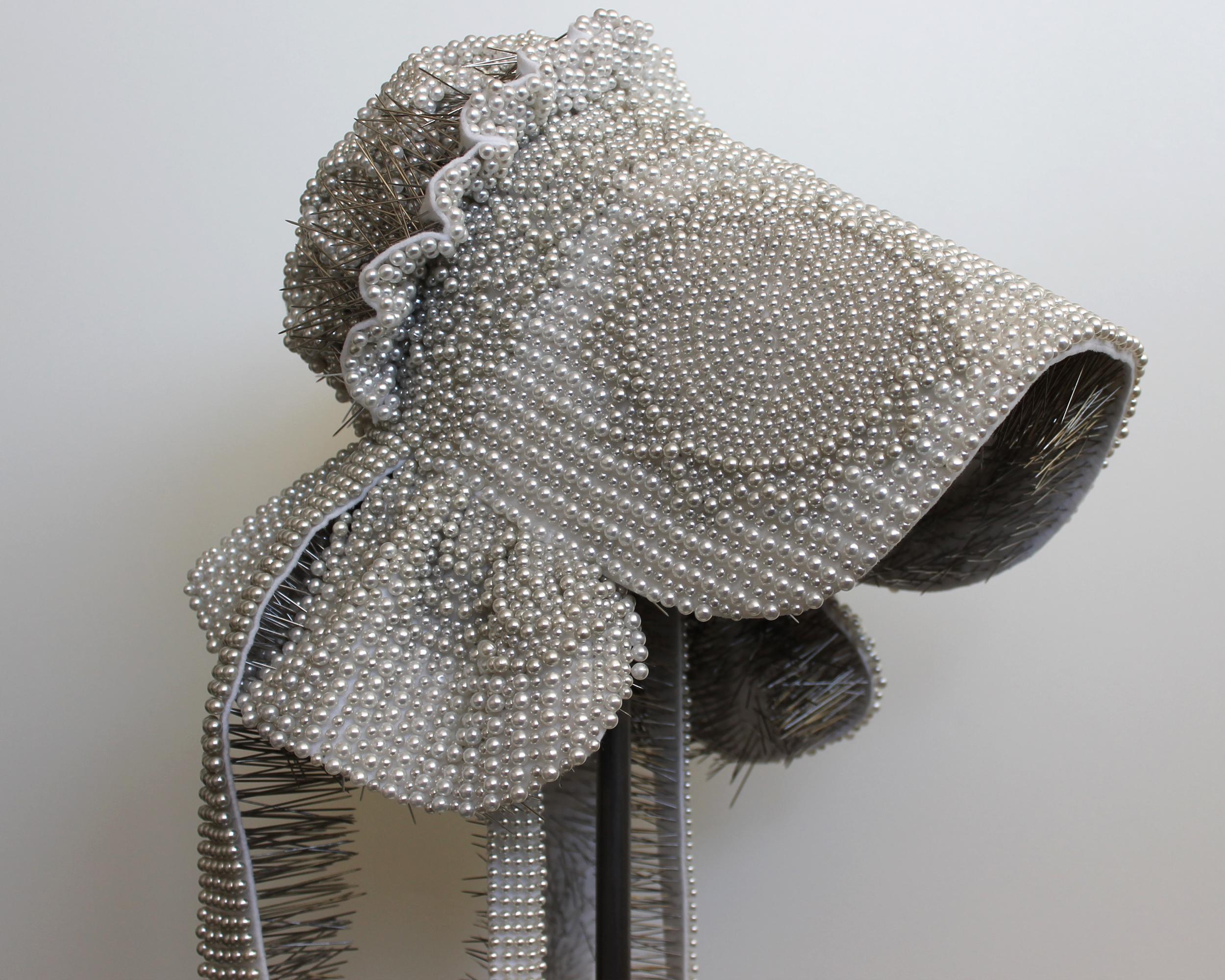 "Seer Bonnet: Elizabeth (Age 16)  17,131 pearl corsage pins, fabric, steel, 61"" x 9.5"" x 12"", 2012-2013"