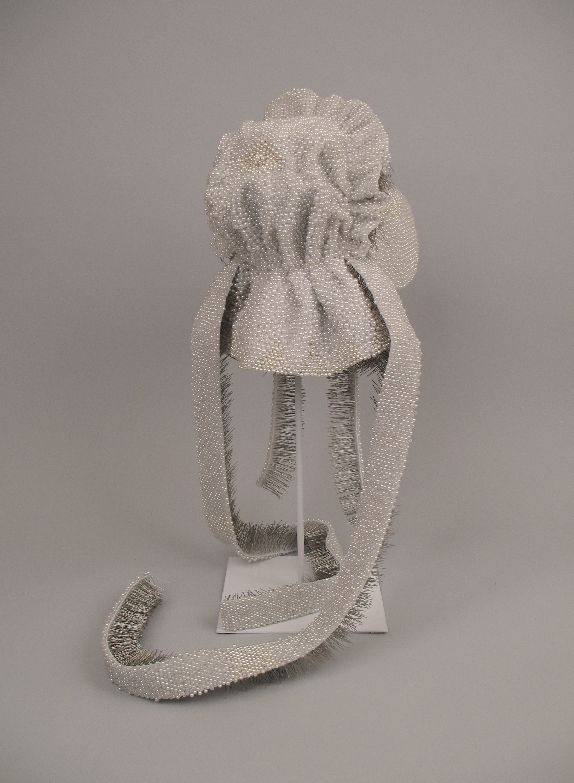 "Seer Bonnet VI  15,564 pearl corsage pins, fabric, 24"" x 11"" x 13"", 2009"