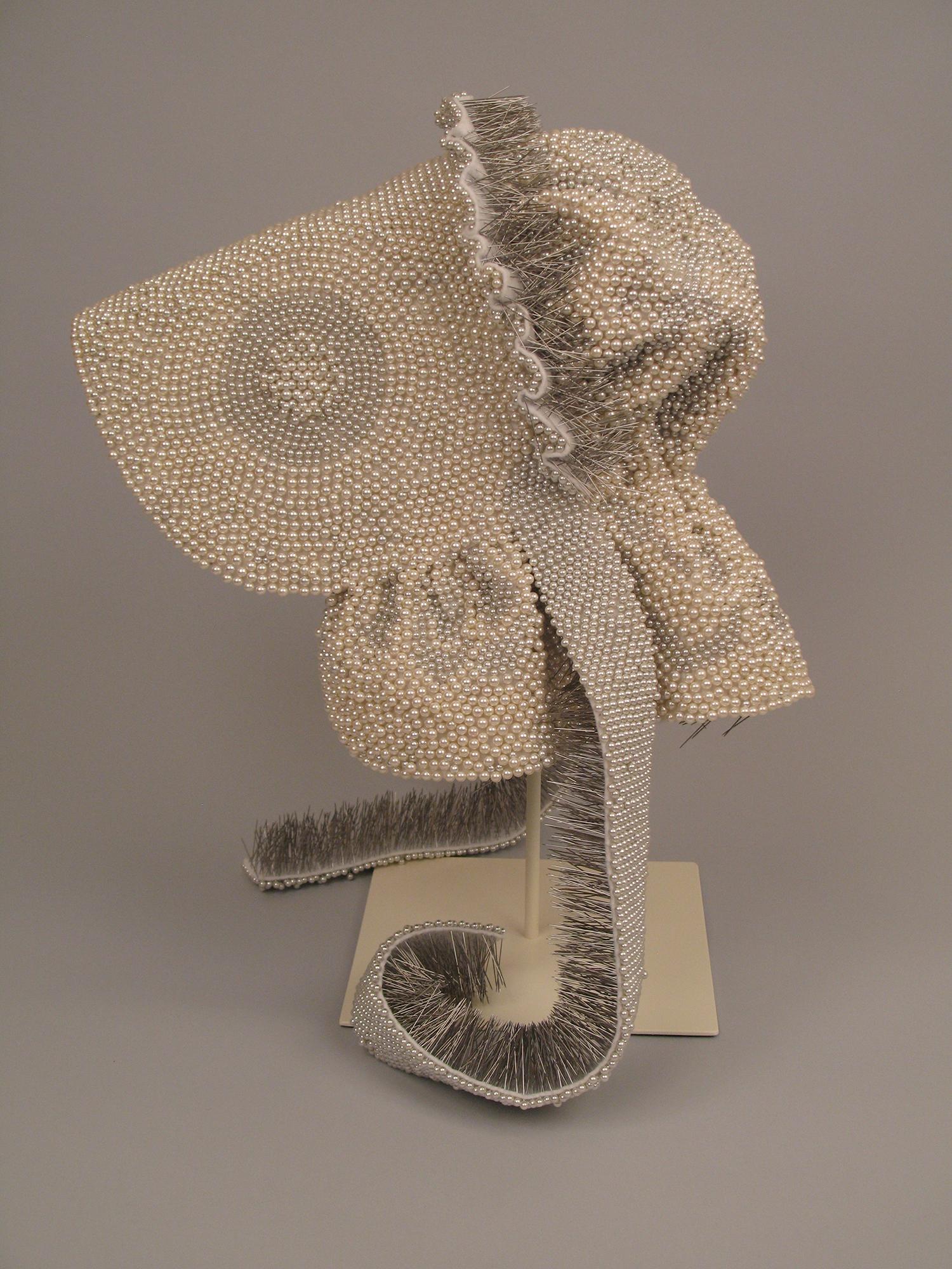 "Seer Bonnet V  14,544 pearl corsage pins, fabric, 19"" x 11"" x 13"", 2009"