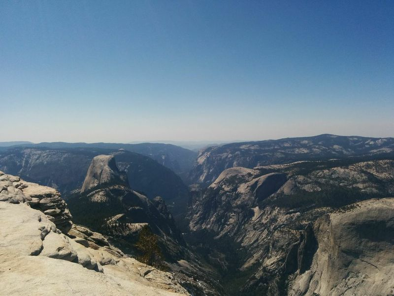 From the top of Clouds Rest, looking down on Half Dome and the Yosemite Valley.