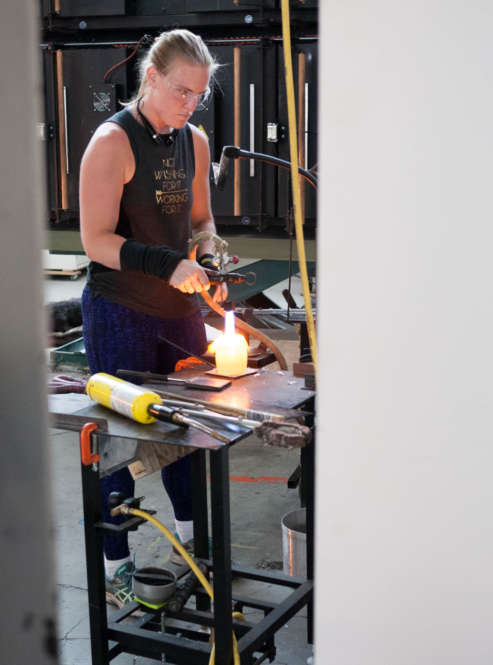 This badass glassblower is putting the finishing touches on a glassbaby votive. Apparently the final step of this glasswork is the most difficult, so only experienced and highly trained glassblowers can do it.