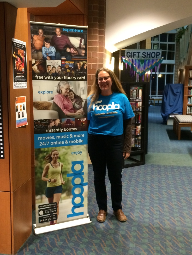 A staff member at Traverse Area District Library shows off the hoopla scrim.