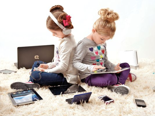 Original picture may be found @ http://www.usatoday.com/story/tech/2012/12/24/digital-gap-kids/1788935/
