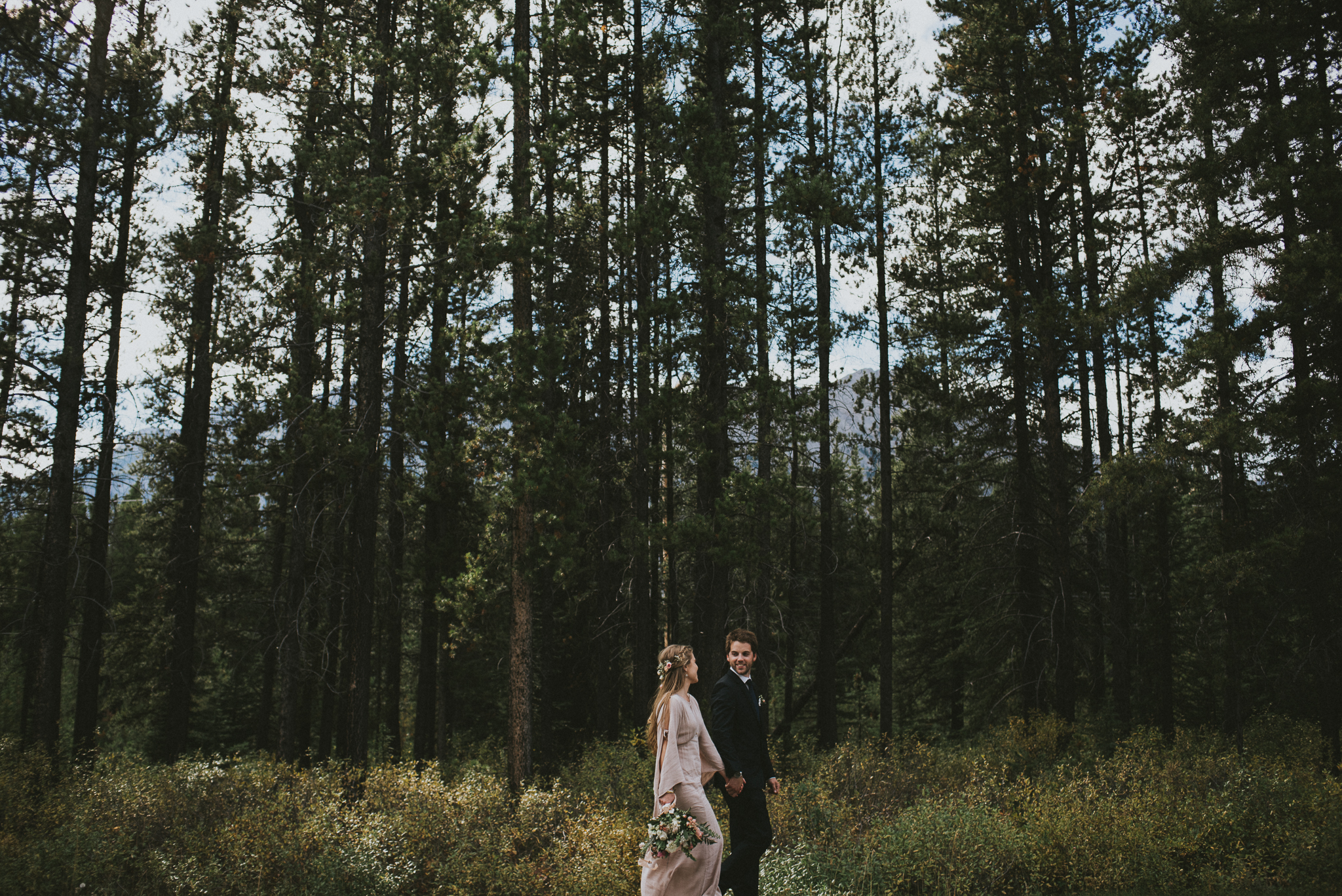 bride groom walk forest kananaskis elopement