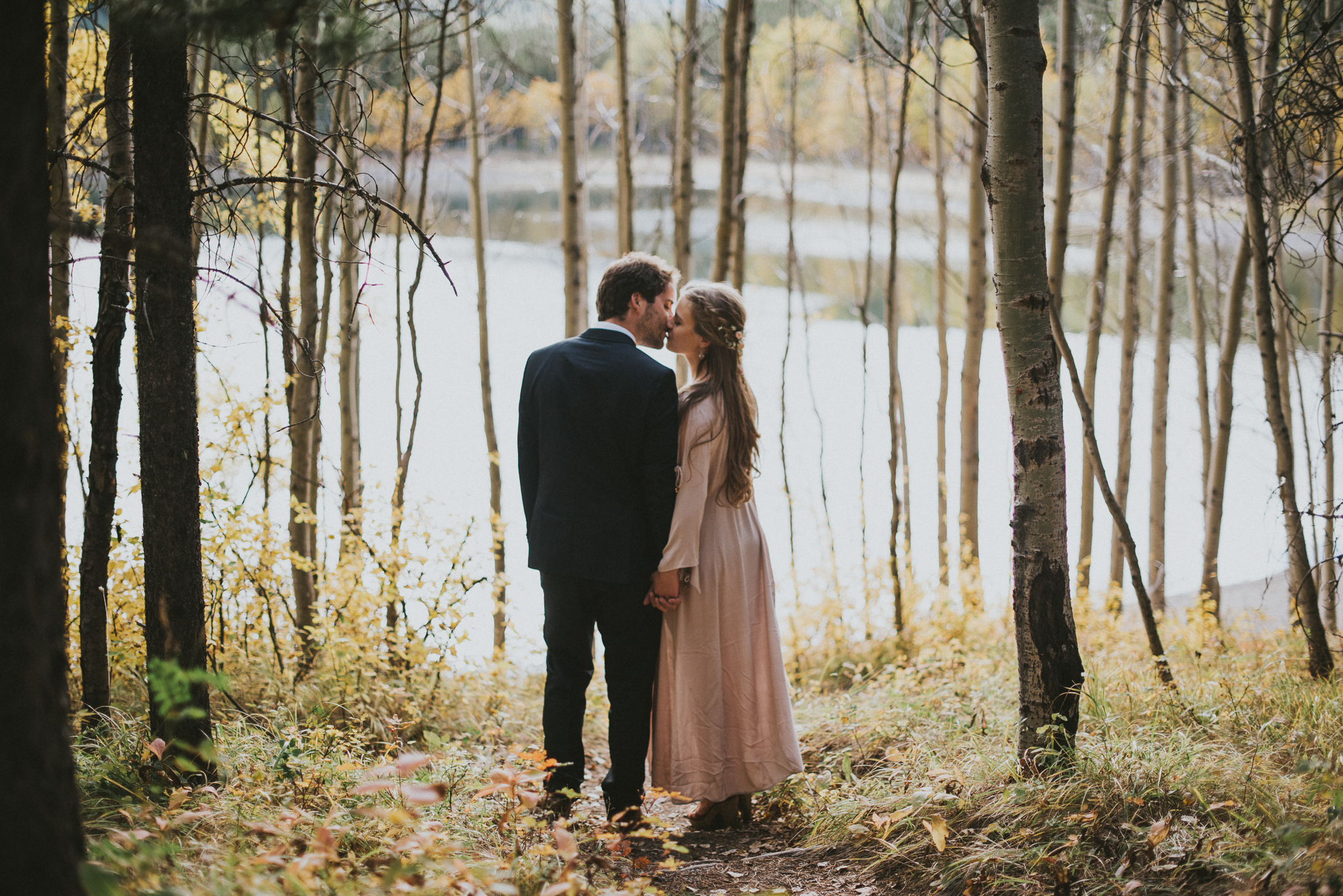 couple kissing forest elopement kananaskis
