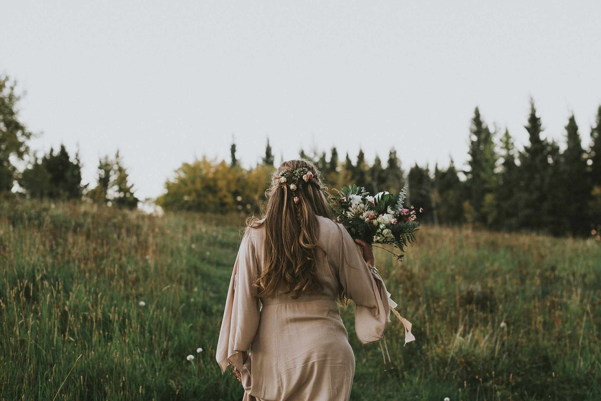 bride candid hair flowers bouquet kananaskis elopement