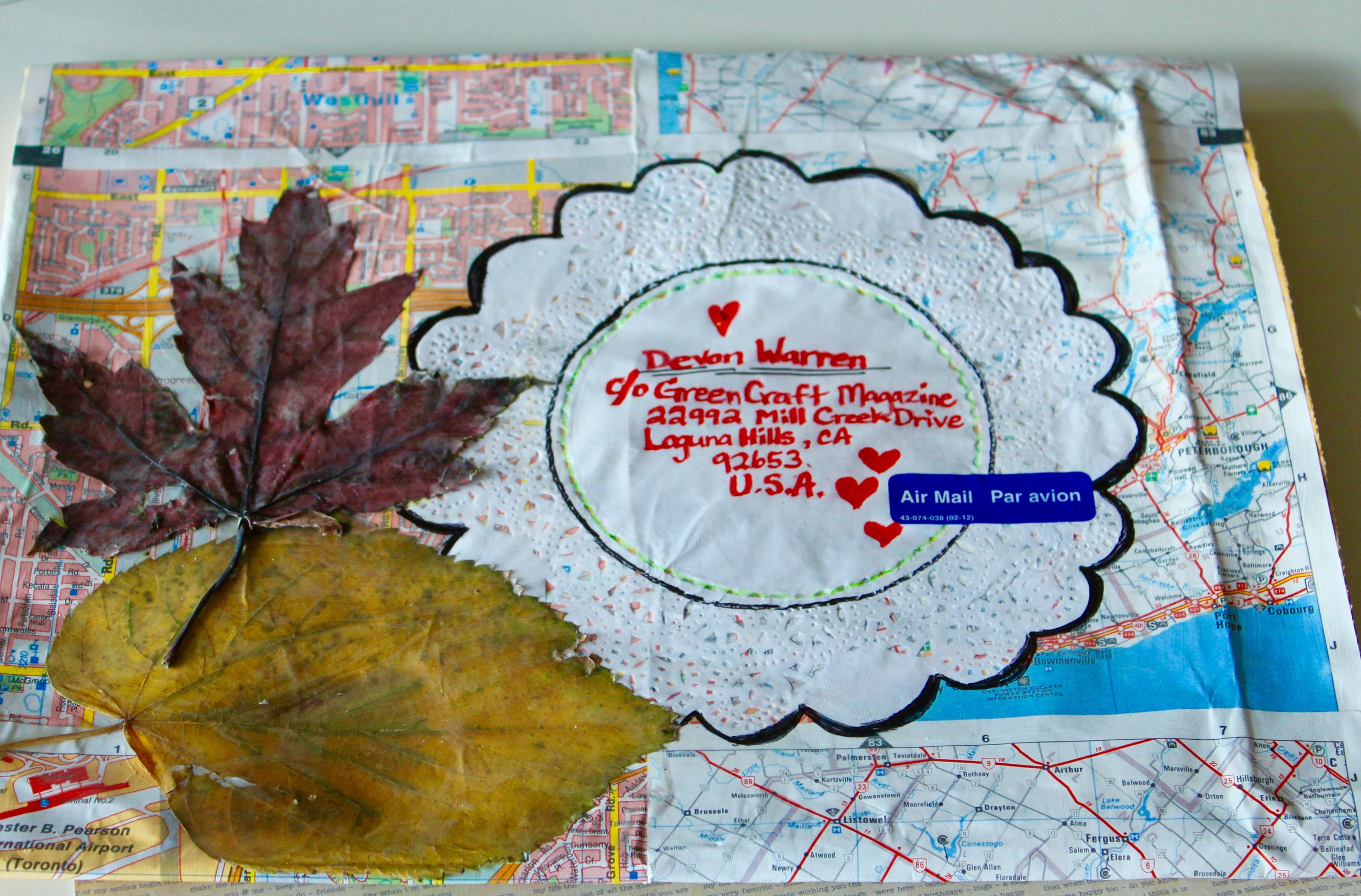 Street maps & doily as label with leaves telling origin and time of year mailed.