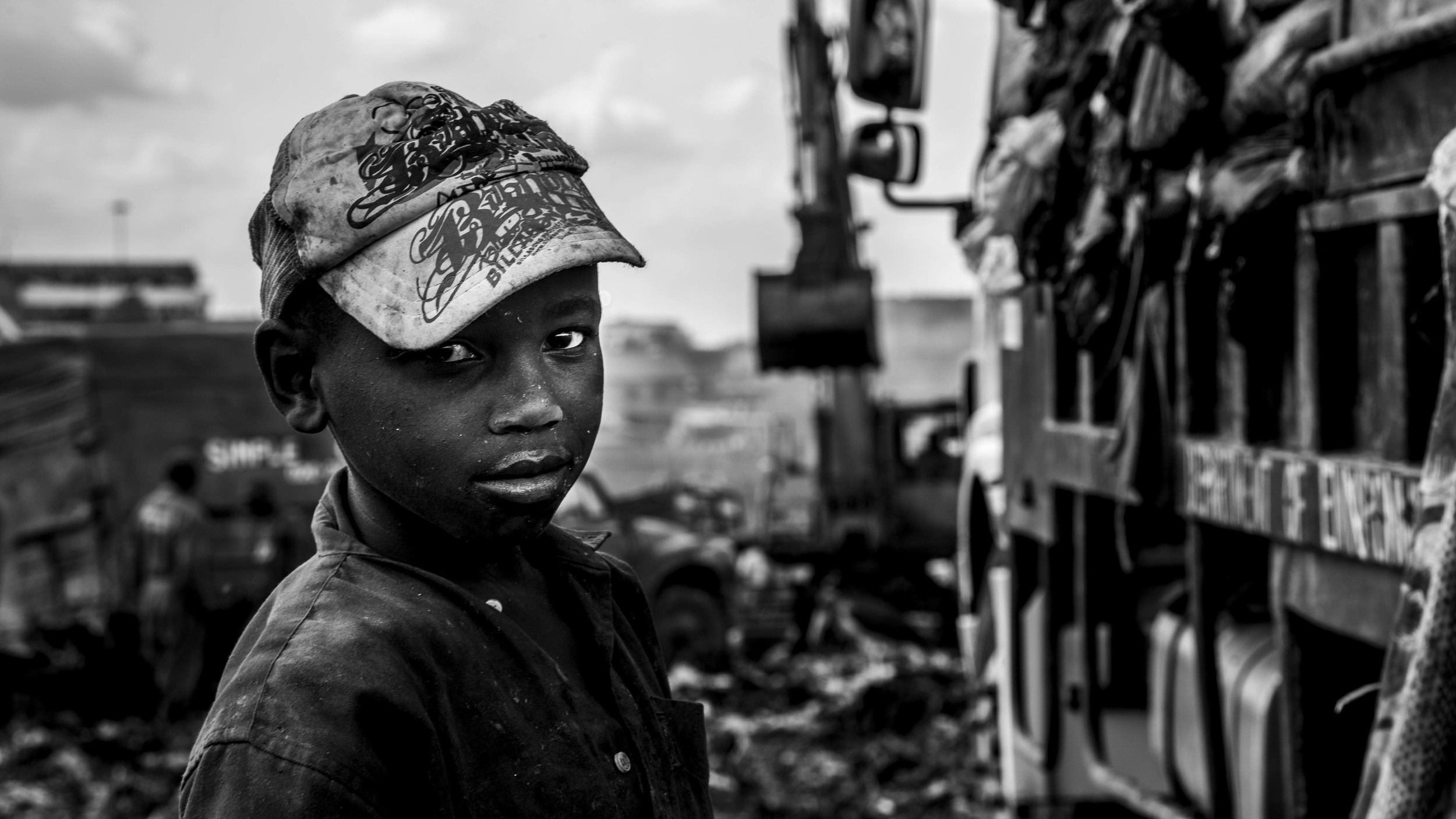 "Kevin is one of the estimated 3,000-6,000 children or ""chokora"" who depend on scavenging from the Dandora Dumpsite for their livelihood. A 2007 UNEP study indicated that 30% of the children tested had heavy metal poisoning, while half of children had blood lead levels equal to or exceeding internationally accepted toxic levels and/or suffered from respiratory problems - upper respiratory tract infections, chronic bronchitis, asthma, fungal infections and so on."