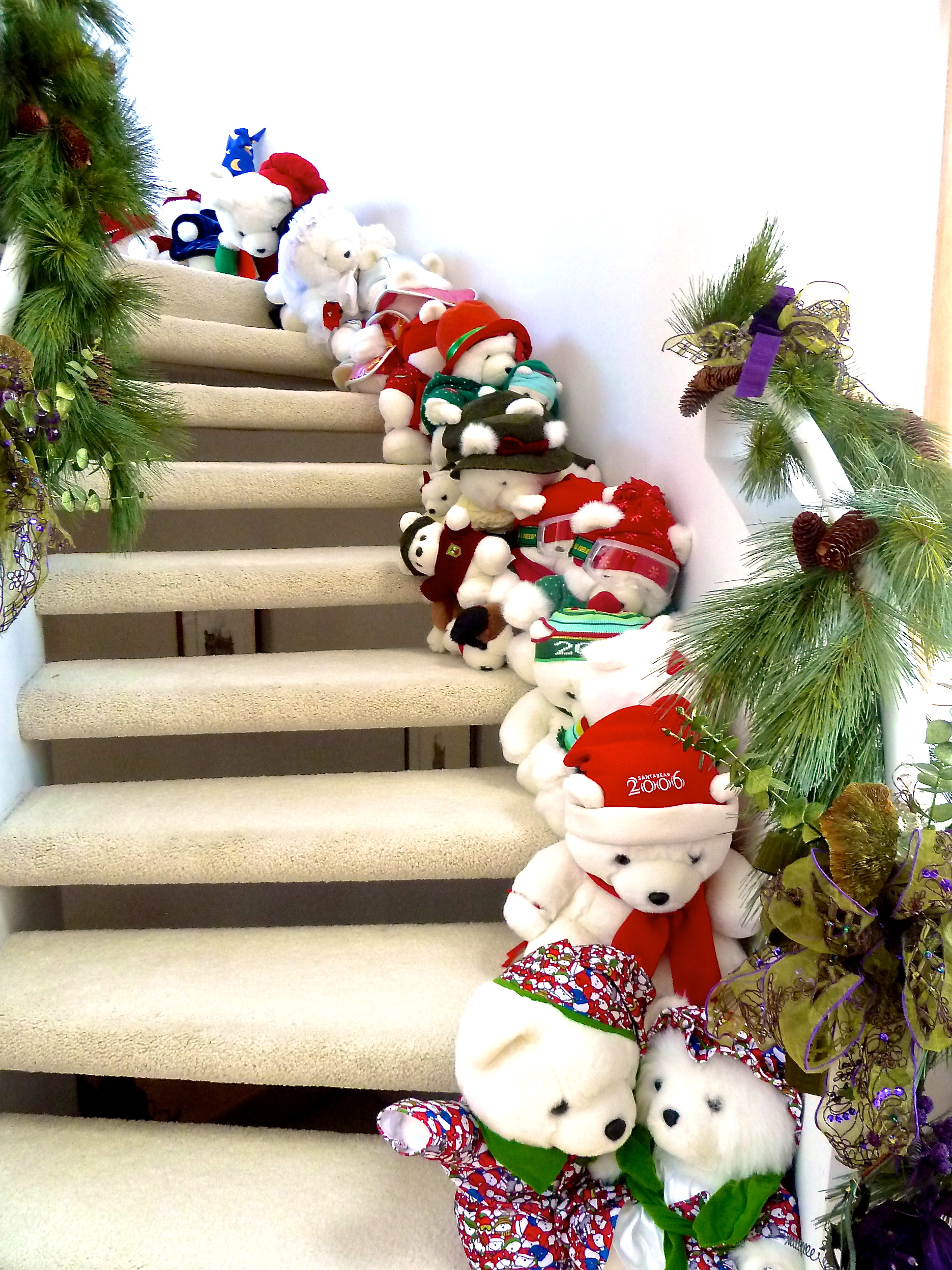 Banisters, Boughs, Bows and Bears oh my! This Santa Bear collection makes kids of all ages smile.