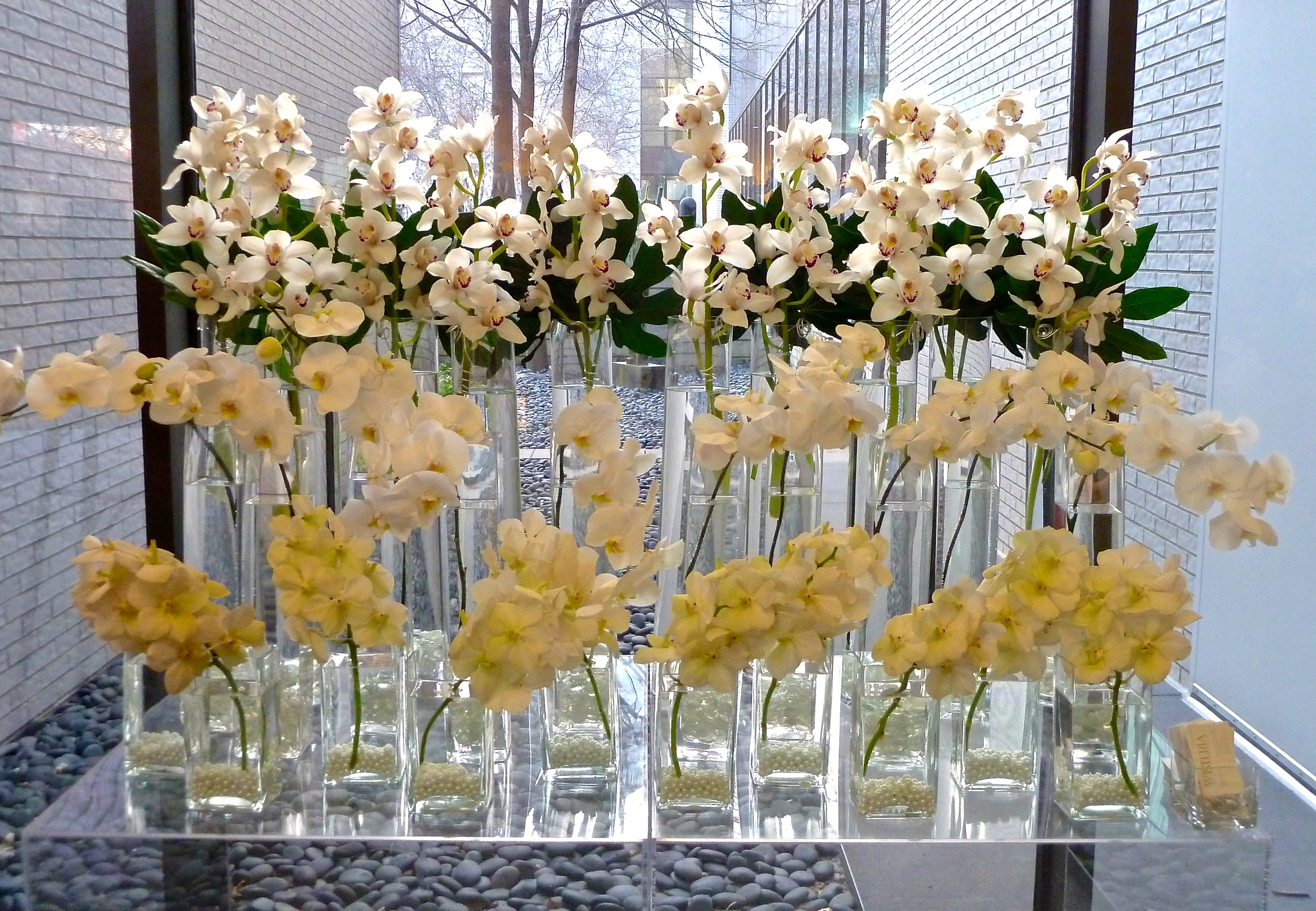 Wisteria Design Studio  in Minneapolis, MN provides an extravagant example of multiples in design beautifully co-existing. Please DO try this at home with your on shapes, sizes and flowers!