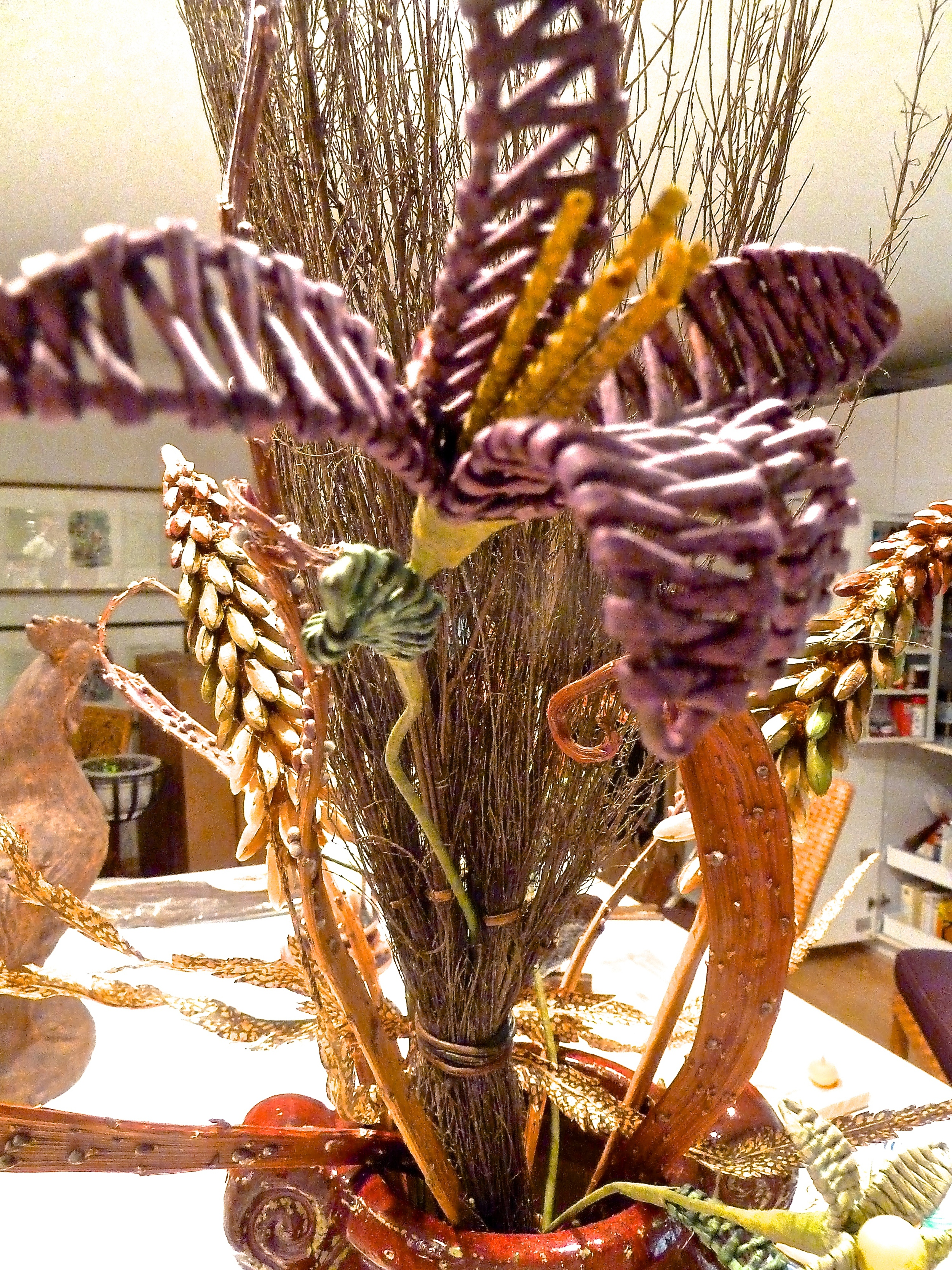 Other flowers can be placed higher up the broom