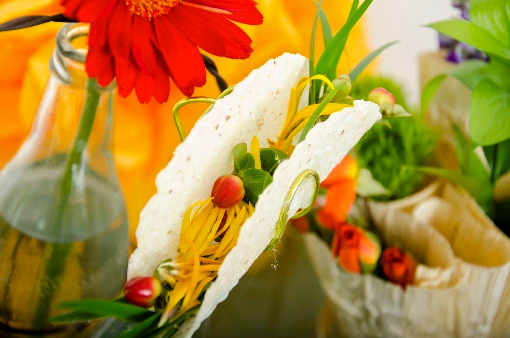 This recipe is easy - your favorite Gerber daisies and some shrub roses. Use the roses for the tomato, the petals for cheese and the greens for lettuce. Experiment and have some fun. The colorful containers and flowers make all the difference. Bakea flour tortilla or use a fake one.