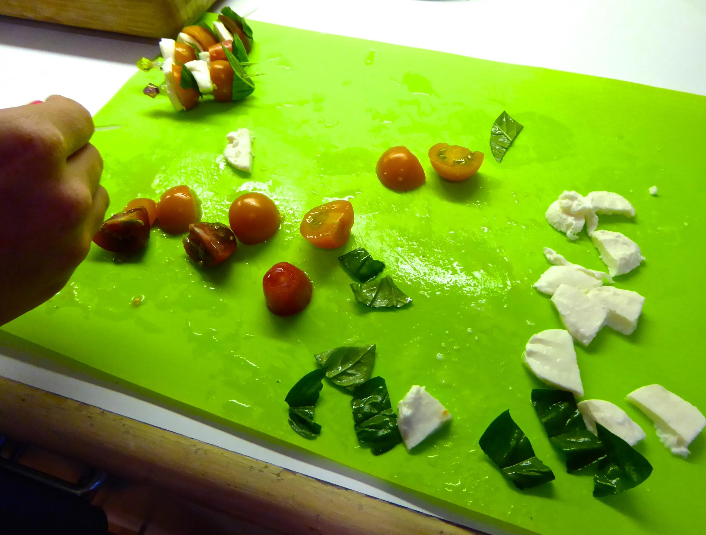 Prep for mini-caprese salad on a skewer