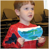 Pre-schoolers at the Crofton Branch of the Anne Arundel County Public Library with paper-plate fishbowls inspired by NOT NORMAN.