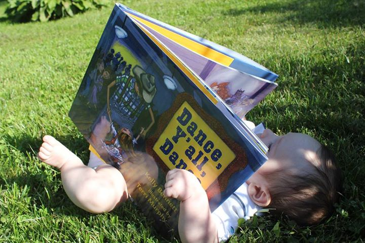 Katie and Liam's baby Ross--a discerning reader,   Yee haw!