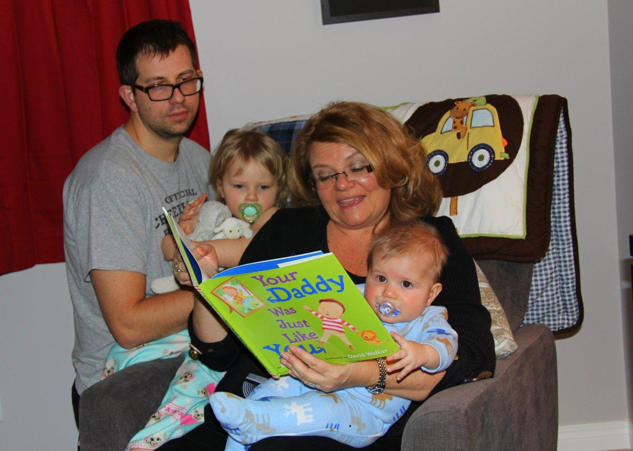 Rebecca & Spencer reading with their folks in Calgary