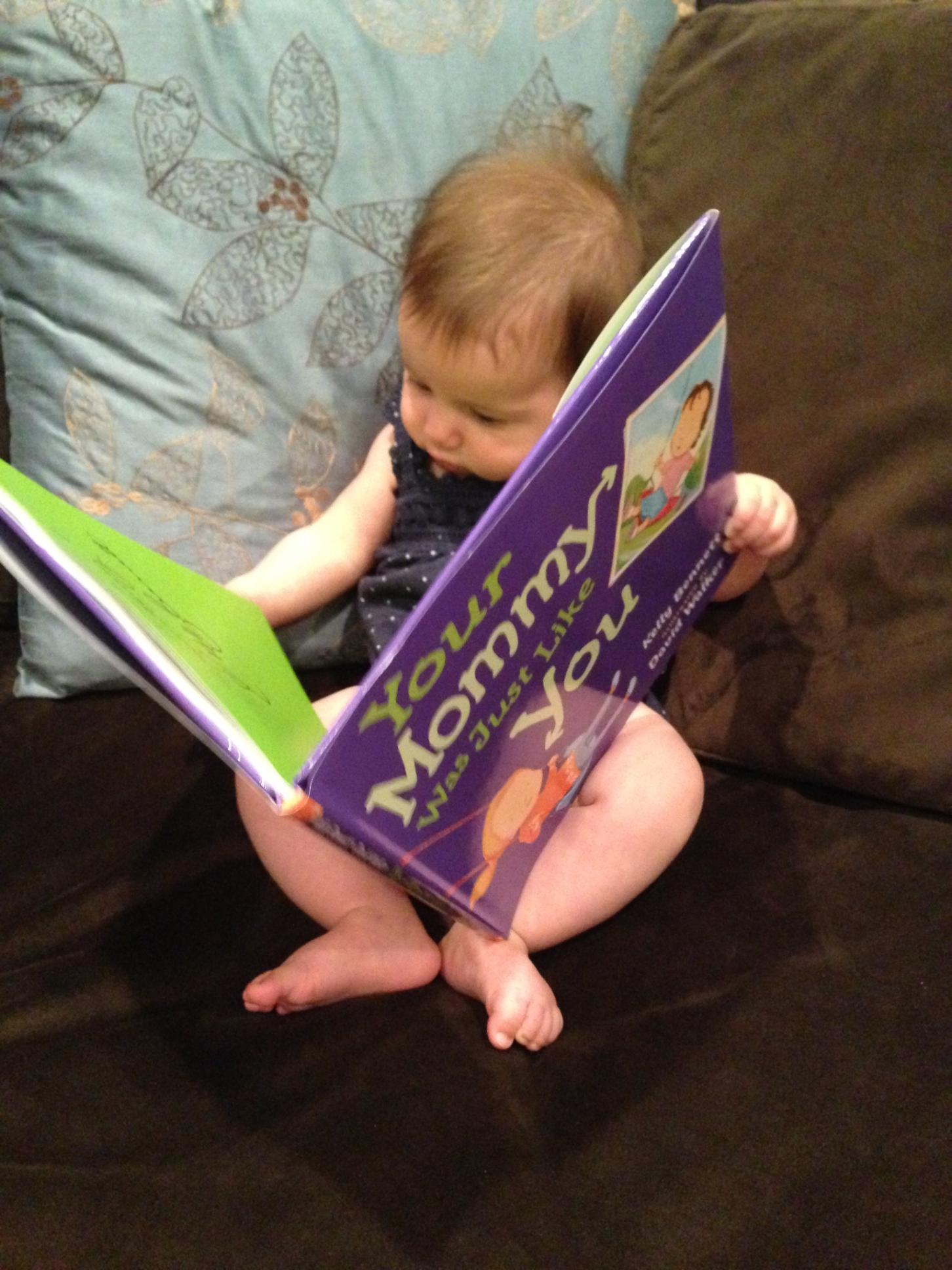 George's granddaughter, Olivia, 5 months and she's already into books!