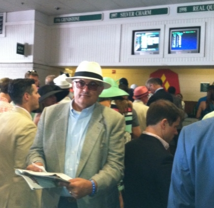 Racing Form in hand, Curtis lines up at the Betting Window