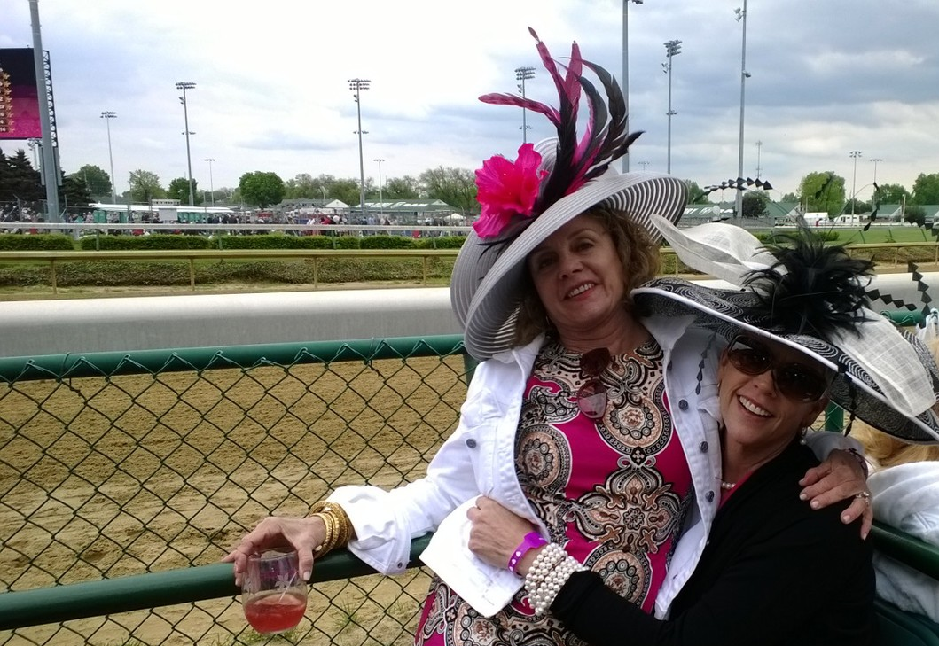 The Oaks is a charity race day to raise funds and awareness for breast cancer:  It is all about the hats, too. And most every one wears pink.  (I have pink on underneath my sweater, really (It was freezing at parts of the day)
