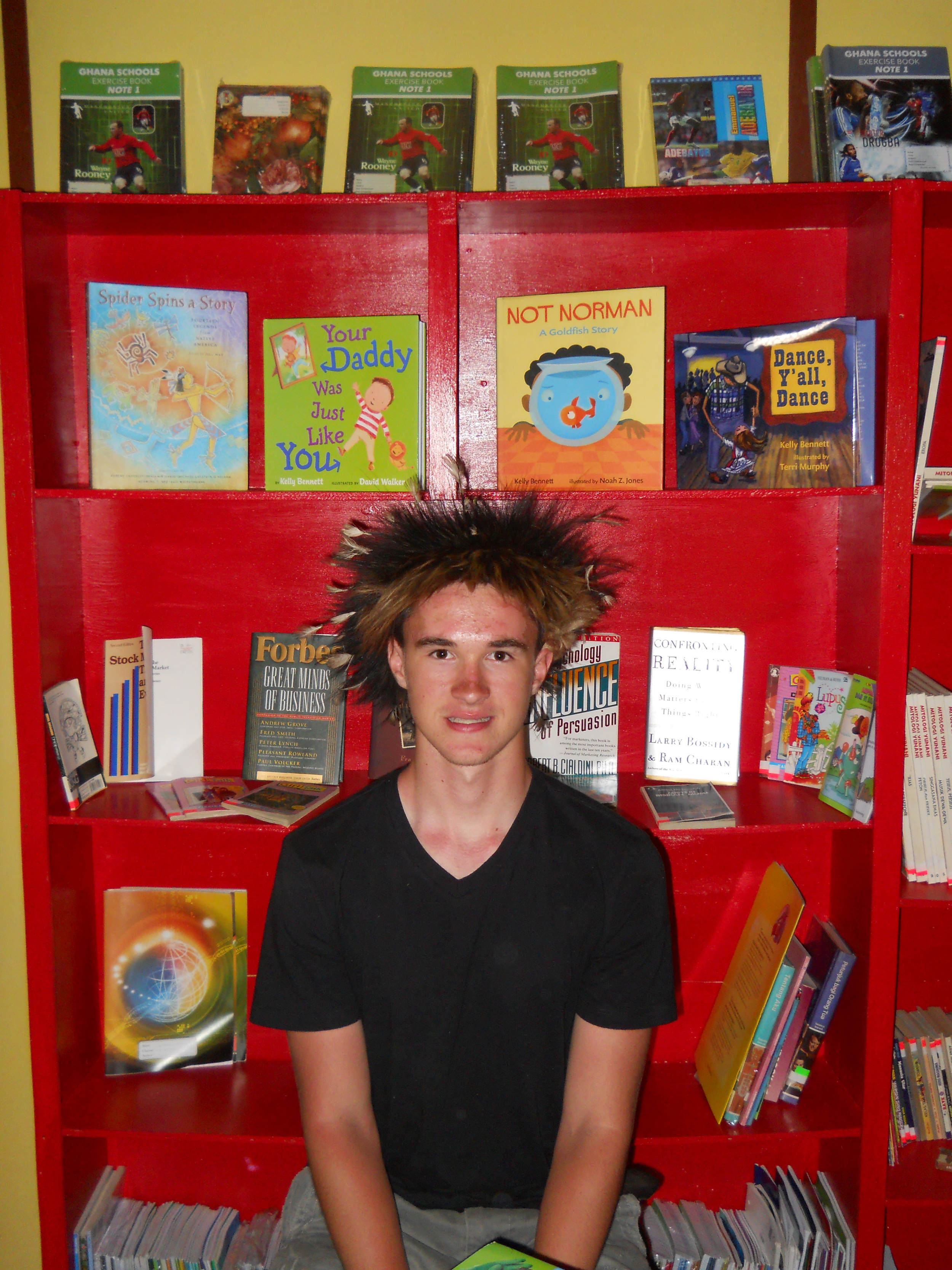 As his senior project at Jakarta International School,Keenan Lambe raised funds to build a library in Papua.Check out his chicken feather headdress!